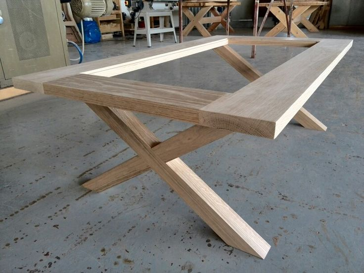 Oak cross leg coffee table with 6mm glass inset top.