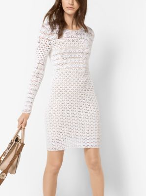 Hand crocheted from soft cotton, this long sleeve dress is designed in a fitted silhouette with a removable slip. Pair it with the season's floral-appliquéd accessories for a bohemian sensibility.