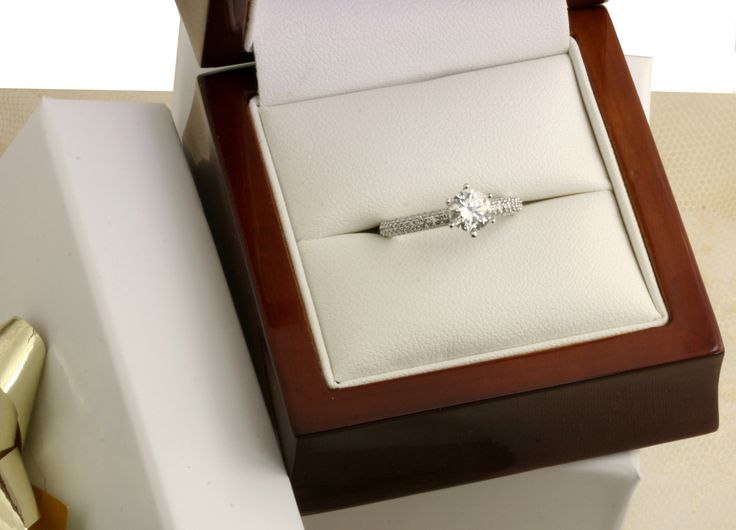 An elegant Diamond Engagement ring with diamond set band in 18ct white gold.