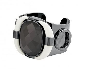 DYRBERG KERN SAIWAIB Chic and glamorous gun metal plated wide cuff made with white resin teeth and grey resin centre.