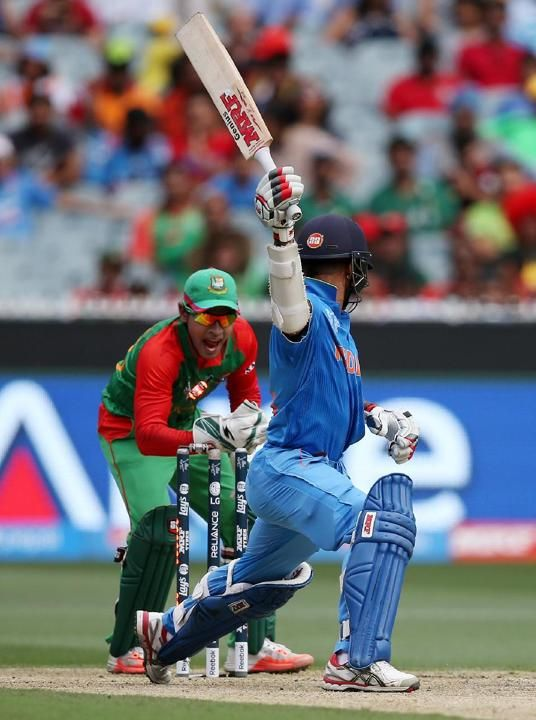 India's Shikhar Dhawan, right, looks back to see he is out stumped by Bangladesh wicketkeeper Mushfiqur Rahim during their Cricket World Cup quarterfinal match in Melbourne, Australia, Thursday, M