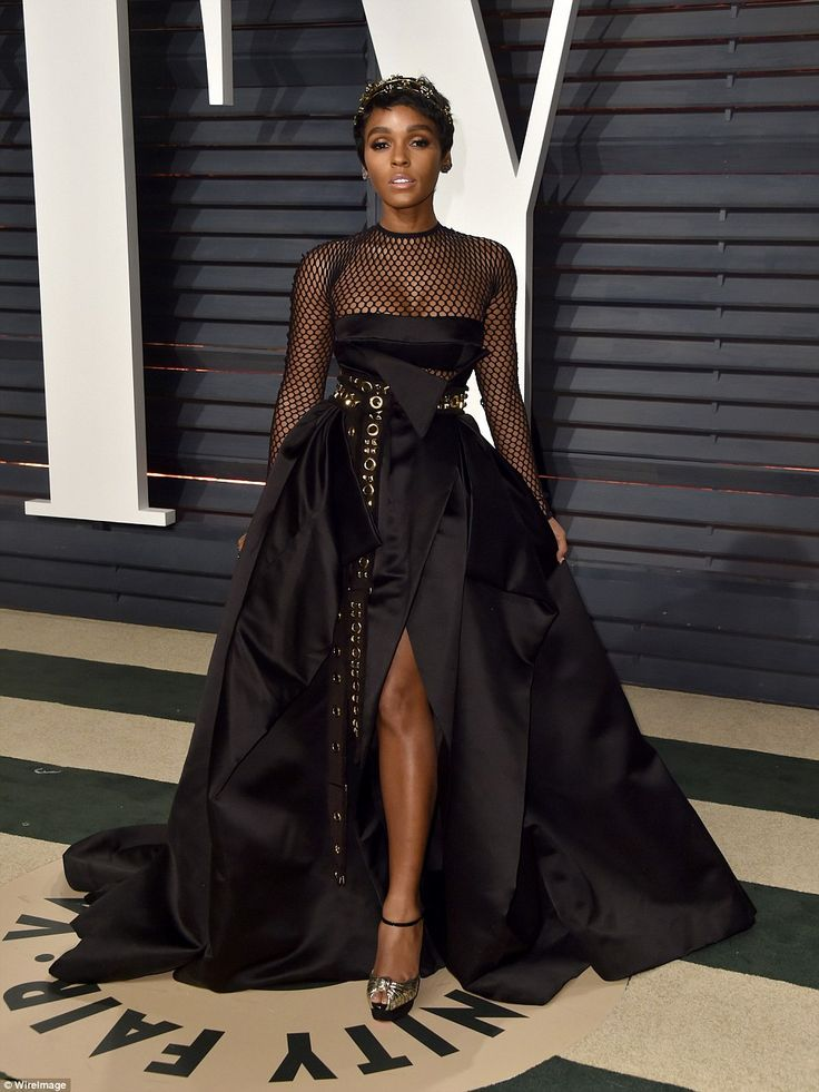 Actress Janelle Monae failed to impress in an over-the-top black gown, which drowned her petite frame and was complete with fishnet neckline at the 2017 Vanity Fair Oscar Party hosted by Graydon Carter at Wallis Annenberg Center for the Performing Arts