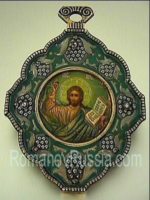 A VERY RARE FABERGE ICON    An antique Russian Icon of Christ Pantocrator by Faberge, made in Moscow between 1908 and 1917.   Silver-gilt oklad (riza) is shaped as a panagia, decorated in the Russian Moderne style of the 1910s with stylized berries and branches on green matte enamel ground.