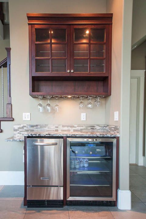 Transitional Basement with stainless steel dishwasher