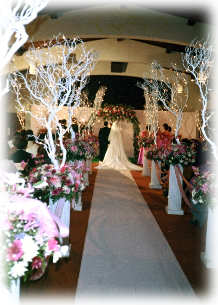 aisle ideas - large white lighted trees on white columns