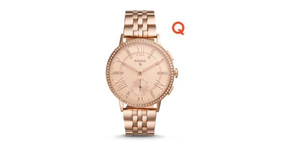 Meet Q Gazer, our hybrid smartwatch that blends analog design with smart connectivity. With our new smart technology, this stylish wrist essential is always on, always connected with a battery life up to six months (based on usage). Dressed in gold-tone stainless steel, the Q Gazer features classic Roman numeral indices with crystal accents. Using Bluetooth™ technology, receive smartphone notifications and accomplish daily fitness goals when the hour, minute and sub-eye hands spin or the…