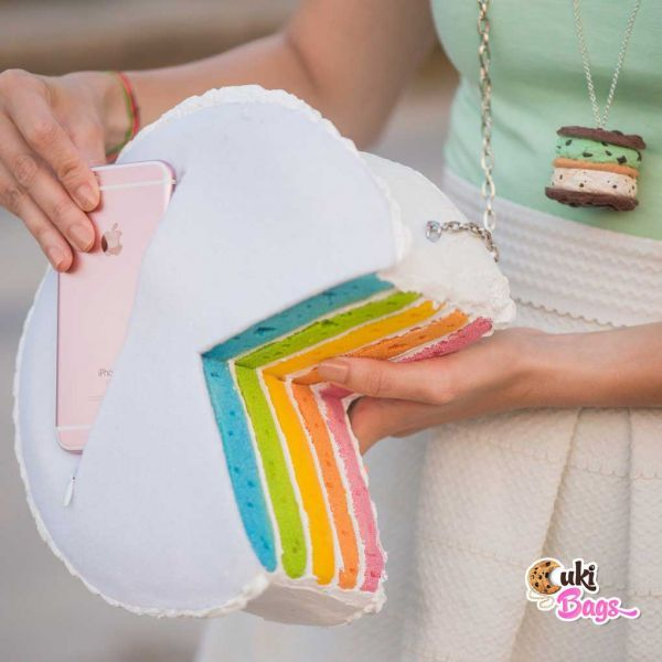 Pink, Orange, Yellow, Green, Aqua Marine, Blue and Purple glazed with white buttercream icing. No, it's not a superpower, it's a fabulous rainbow cake clutch / bag. Piece by piece, cake by cake, we created especially for you this powerful and colorful rainbow layered cake purse/clutch bag, with rainbow sprinkles on top. Available also as a piece of cake rainbow purse/clutch bag. WORLDWIDE DELIVERY - FREE SHIPPING for orders over $200;