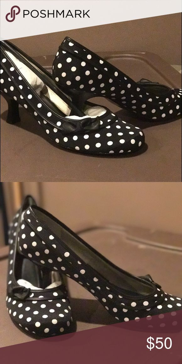 Classy and cute polka dot pumps! Cute and classy black pump with a white polka dots.  Very comfortable heel.  Brand new with box.  Never worn Steve Madden Shoes Heels