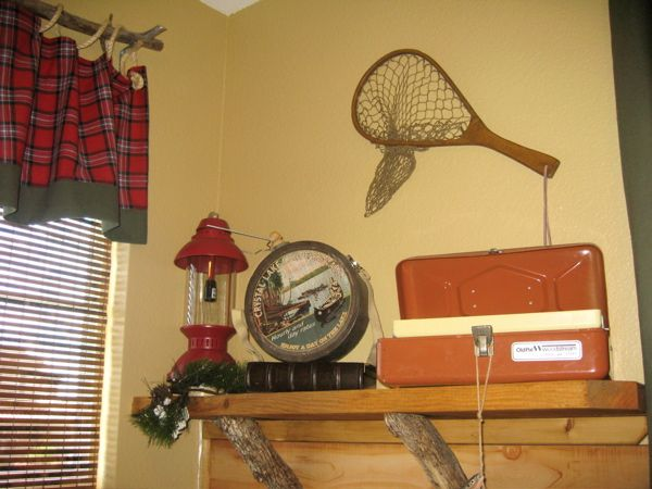 Love the branch used for the top treatment, the latern, canteen, and old metal tackle box....  Vintage yeah!