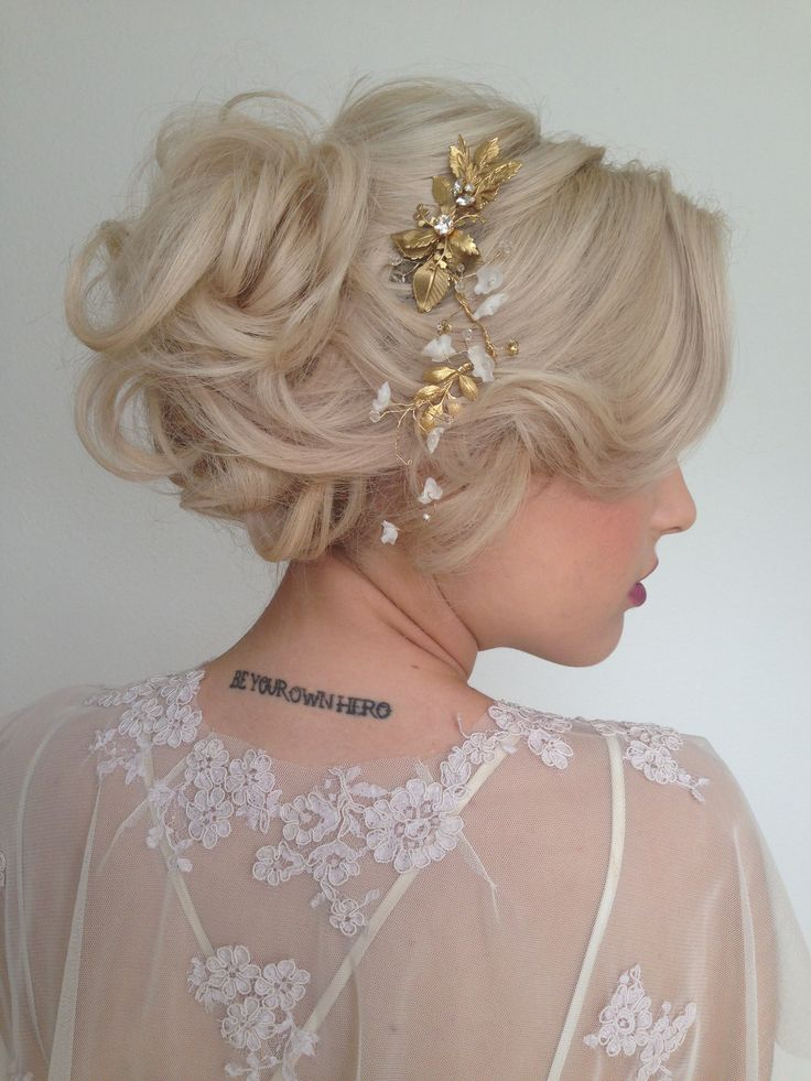This is, to date, one of my favorite looks that I've styled.  I love Jessica's tattoo gently offsetting the hyper-femininity of the overall look.  Wedding hair by Heather Chapman.