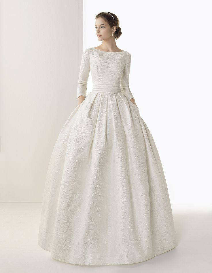 Long brocade wedding dress and train with hemstitch detail. Rosa Clará 2014 Collection.