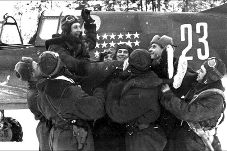 "The Soviets welcomed the heavily armed P-40. Senior Lieutenant N.F. Kuznetsov is congratulated after his 27th victory, his ""Lend-Lease"" P-40K in the background. (National Archives)"
