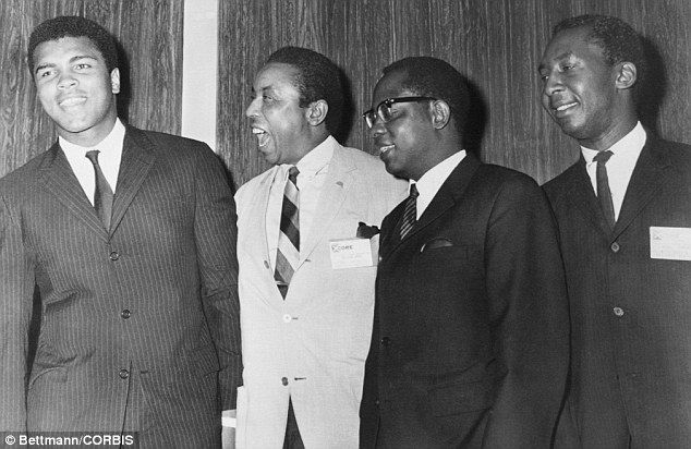 Independence Day: The fighter attends a dinner honoring Floyd McKissick (second left), the director of Congress of Racial Equality. The dinn...