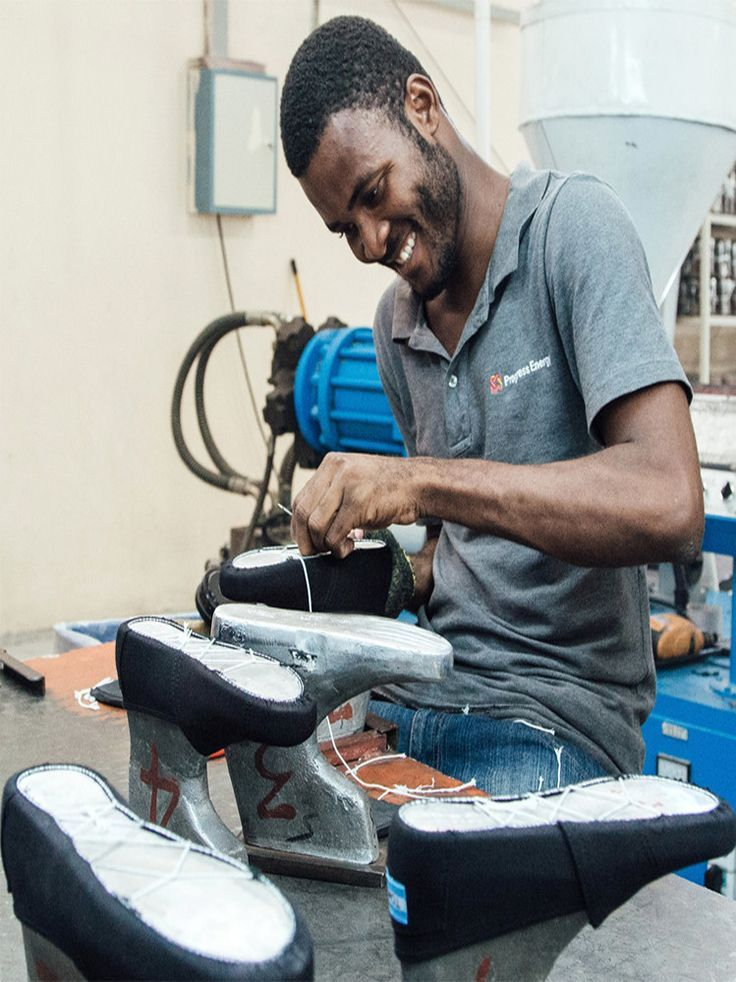 We are creating new jobs in Haiti. An employee at our factory near Port-au-Prince completes the string lasting process on Giving Shoes that will be given locally. #OneforOne