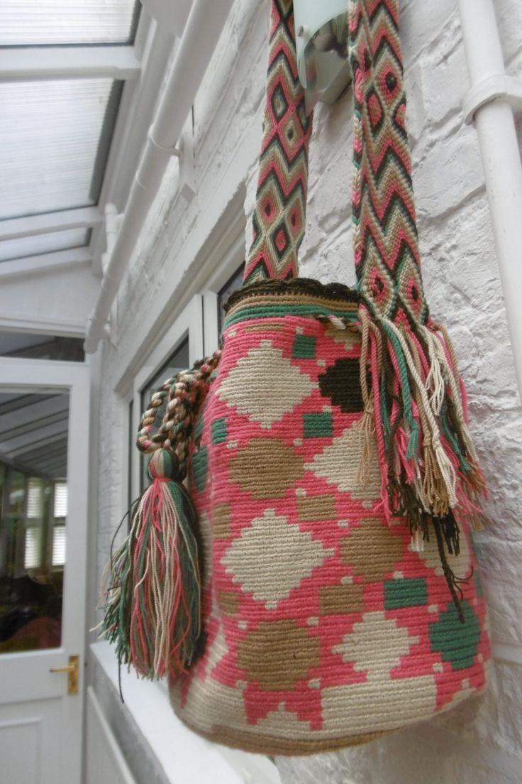 Gorgeous hand-woven, multi-coloured shoulder bag made my the Wayuu women of La Guajira, Colombia.  Wayuu bags or mochilas are a…