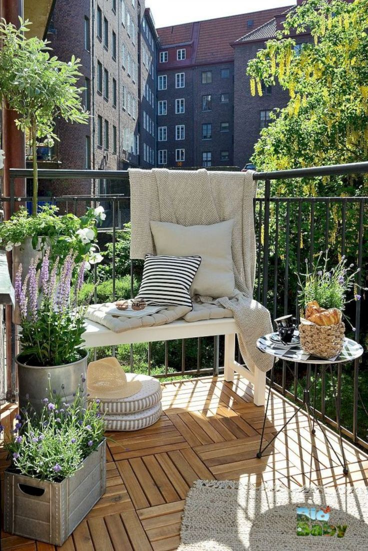 40 rooftop seating area surrounded by a wall of green and hanging plants - Matchstick Tile Garden Decoration