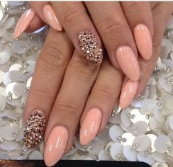 Peach pointy nails with golden studs