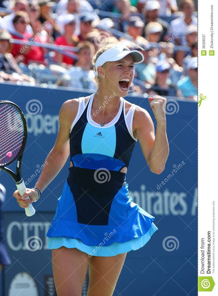 NEW YORK - AUGUST 27 Professional tennis player Caroline Wozniacki during first round match at US Open 2013 against Ying-Ying Duan at Billie Jean King National Tennis Center on August 27, 2013 in New York