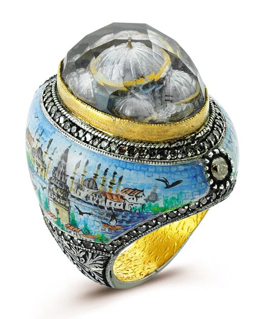 "It's an ""ART IS IT"" collection which is studded with diamonds and Hand painted with GALATA TOWER on this side with mosaic effect and ottoman style carving on outskirts of ""ISTANBUL"" ring with 24k /925, beautiful DOMES hand carved inside the stone with reverse-intaglio technique which takes you LIVE in a Pasha era.  So why not WEAR YOUR ARTS !!!!!"