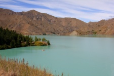 Lake Benmore filled with Glaciated water which is formed from the largest man-made earth water-retaing structure in New Zealand. part of the Waitaki Valley.     Read more about the valley at http://travel-2-newzealand.com/places-to-visit-in-new-zealand-the-waitaki-valley/