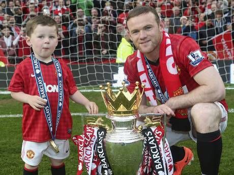 Manchester United's Wayne Rooney with son Kai last year