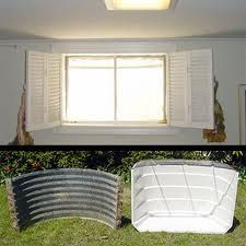 Let there be light! - SunHouse Basement Window Well Enclosures. Could paint the corrugated metal white??