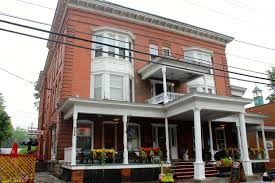 Naples Hotel  Naples, New York - Naples Hotel was built in 1895 and is rumored to be haunted by 6 or more ghosts. One is a man named Topper; another is a woman who has her ghostly children in tow. According to witnesses, the ghosts like to lock doors, turn on the lights, and move pictures around.