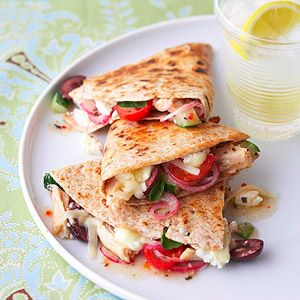When it's snack time, try this quick-and-easy tortilla sandwich recipe with roasted chicken, feta cheese, tomatoes, and vegetables drizzled with a Greek vinaigrette dressing.