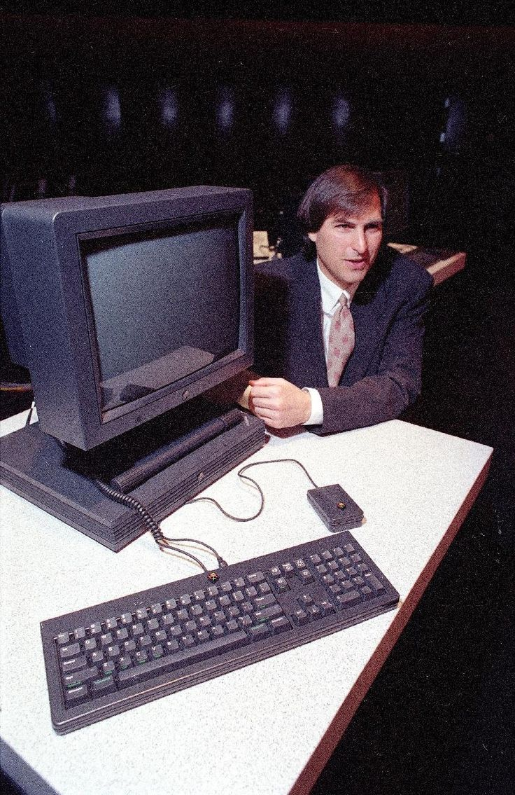 1990 - Steve Jobs, president and CEO of NeXT Computer Inc., shows off his company's new NeXTstation after an introduction to the public in San Francisco. (AP Photo/Eric Risberg, File)