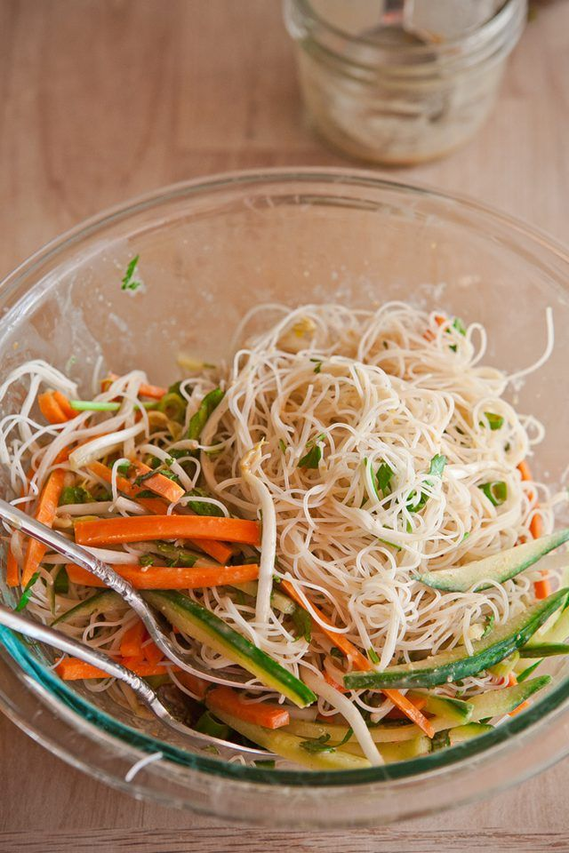 Cold peanut noodle salad tossed in a bowl