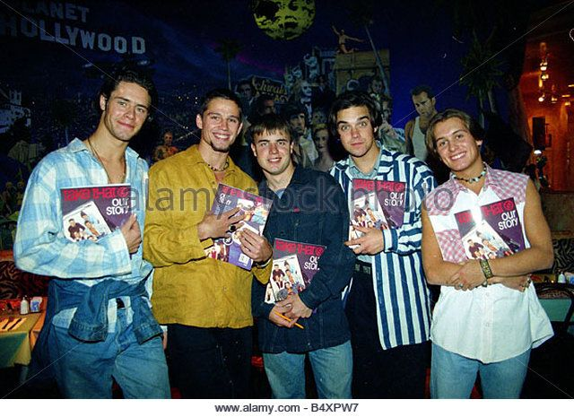 Pop group take that holding copies of their new book beore signing them for fans at Planet Hollywood Left to right - Stock Image