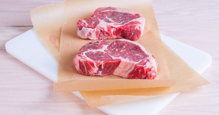 Rib eye steak is a tender, succulent steak cut from the outer edge of beef ribs. Simple cooking methods bring out the natural flavor of the meat. Cooking rib eye steak in a slow cooker is a particularly effortless way to cook rib eye steak, resulting in juicy, mouthwatering meat.
