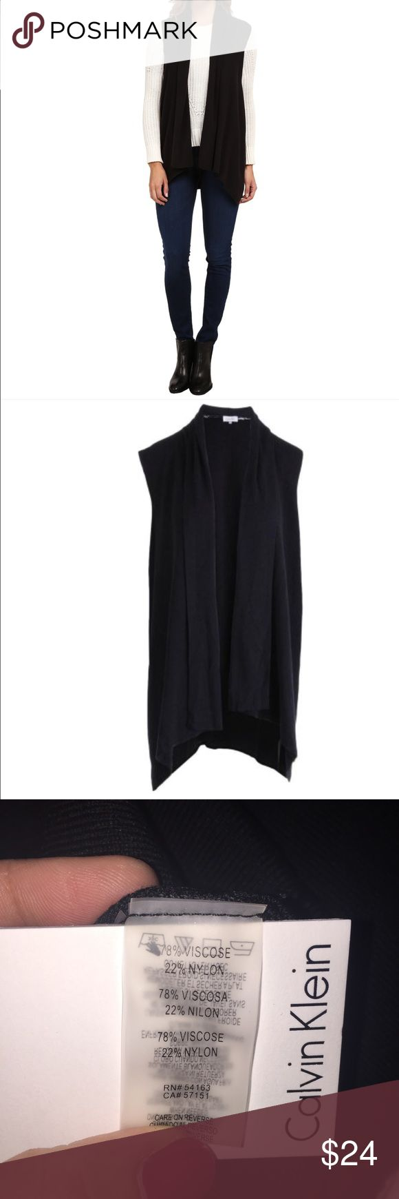 Calvin Klein Black Sweater Vest Elegant sweater vest by Calvin Klein. Warm, soft, and versatile Calvin Klein Jackets & Coats Vests