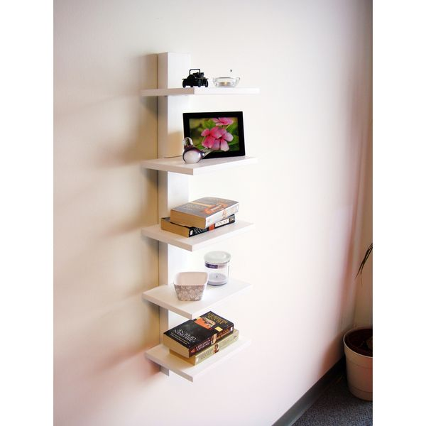 Carve out a prominent display niche in your living room or bedroom with this wall shelving unit featuring five shelves that give you plenty of room for books and photographs. The shelves are attached