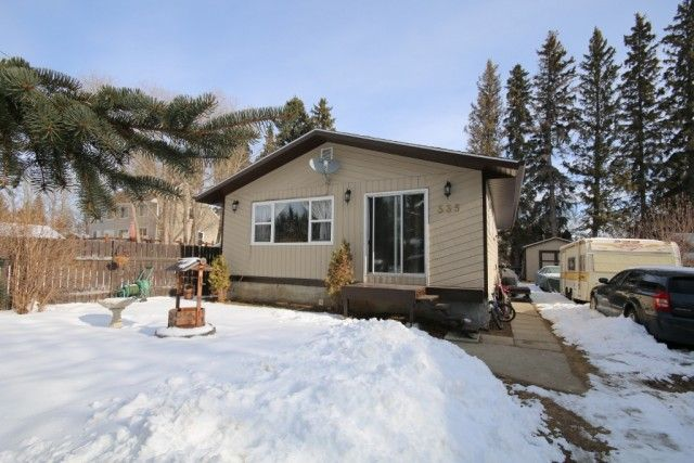 CUTE & AFFORDABLE BUNGALOW (Parkland County) Cute & affordable is this 953 square foot bungalow in the community of Spring Lake, Parkland County. Situated within a cul-de-sac, backing onto crown land & towering pine trees. Offering; 4 bedrooms & 1 bathroom, an eat-in kitchen with loads of white cabinetry, ample counter space, stainless steel appliances (some newer), & slider doors to the deck, main floor laundry with newer washer & dryer, partially finished basement with lots of storage…