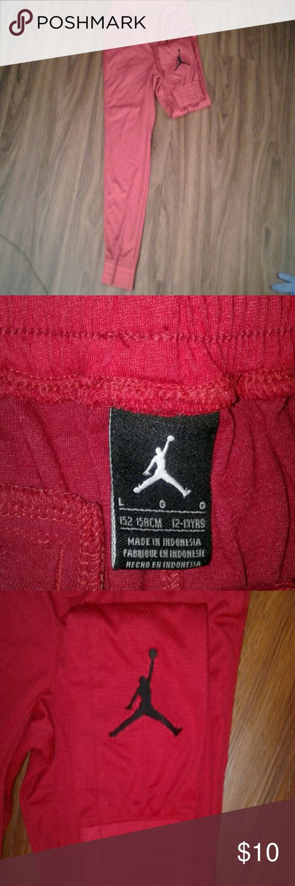 BOYS JORDAN Sport JOGGERS Red joggers with Jordan sign on bottom of left leg. Only worn once. Cotton lined on inside. 65%polyester 35%cotton.. Jordan Bottoms Sweatpants & Joggers