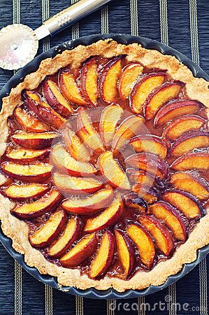 Nectarines tart in a metal tray on a table