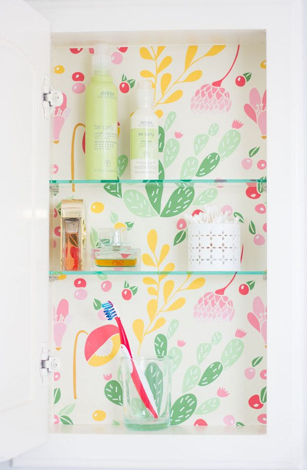 Cover the inside of your medicine cabinet with contact paper. | 25 Insanely Cute…