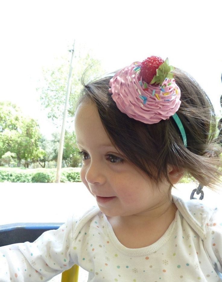KATY PERRY HEADBAND-  fake cupcake great photo prop and katy perry costume ,first birthday party cupcake hat  ,pink icing. $23.99, via Etsy.