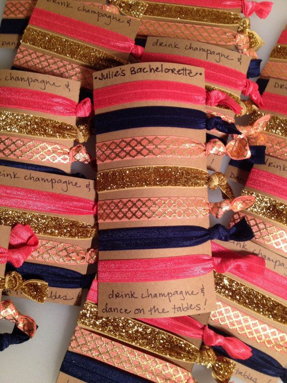 Bridal Party Gifts Bachelorette Party Favors by tiesforteams --> OMG so cute!! Customized bachelorette party favors! Creaseless hair ties in the bride's colors!