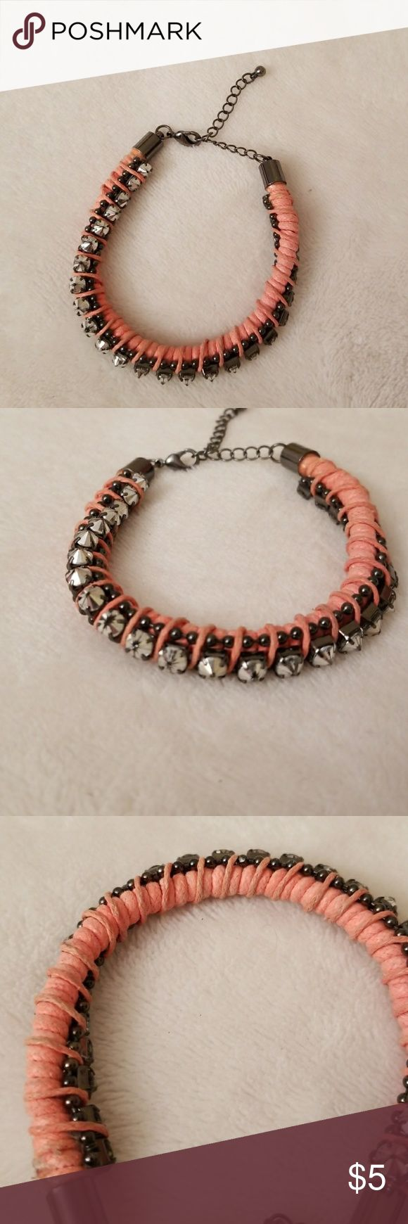 Spike bracelet Coral spike bracelet, worn a few times but in good condition. Slight discoloration and wear on spikes pictured. Pretty sure it's from American Eagle. Jewelry Bracelets