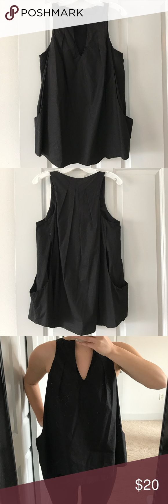 Like New- Phard Razorback Pocket Top Black flowy fit pocket blouse. Razorback top, v neck, 28 inches from top hem to bottom. Inside has a double lining through the bust area- no lining in stomach of shirt. (No worries- not at all see through!) Worn once or twice. Phard Tops