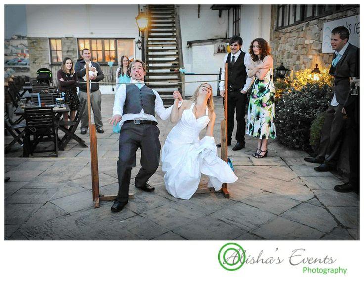Beach / british seaside wedding theme Wedding games fun - limbo  Copyright: www.alishaseventsphotography.co.uk