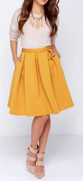 We can't blame you if you fall head over heels for the Perfect Balance Mustard Yellow Pleated Midi Skirt, its cute style is mesmerizing! The...