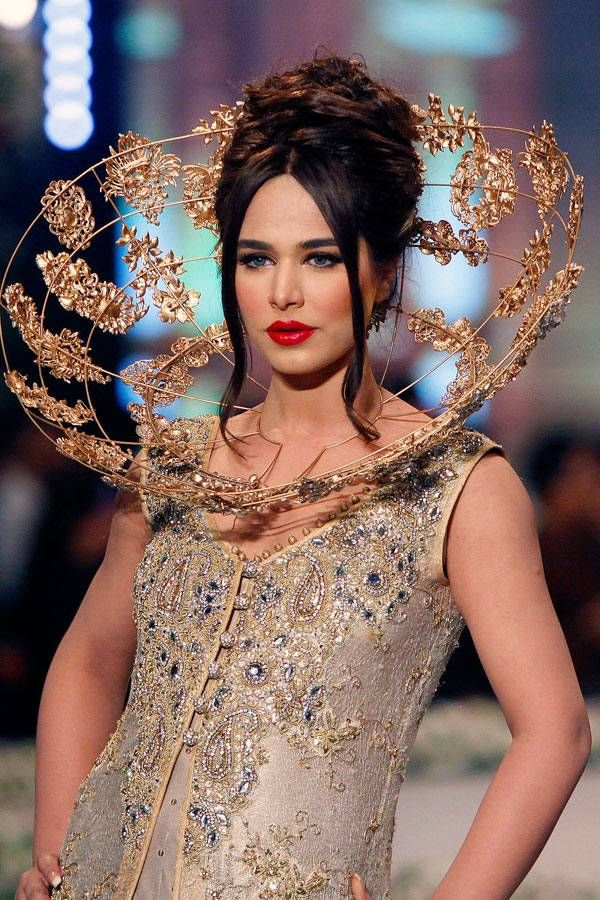 A model presents a creation by designer Tabassum Mughal on the third day of the Bridal Couture Week in Karachi, Pakistan, Monday, May 12, 2014.