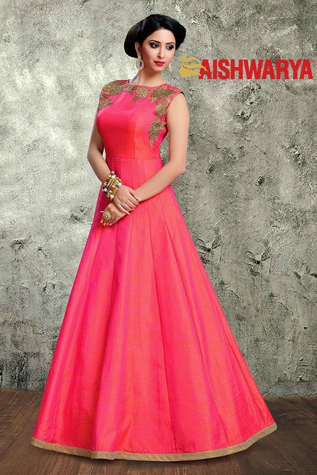 This lovely gown is sure to grace any lady with classic style and sophistication. Buy Gown online - http://www.aishwaryadesignstudio.com/graceful-coral-pink-rich-designer-gown