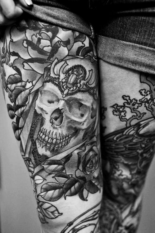 leg tattoos | Tumblr  I love the sheer amount of detail that's gone into creating this tattoo. The depth  that has been given to the tattoo creates a 3-D effect while the cartoonish styled flowers helps balance the overall appearance of the tattoo.