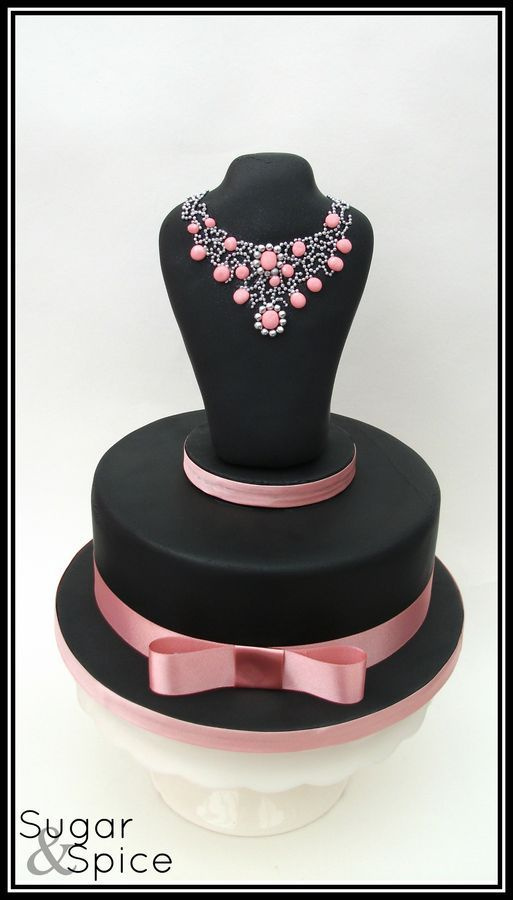 A surprise 21st birthday cake - chocolate mud with an RKT topper deco'd with fondant stones and dragees
