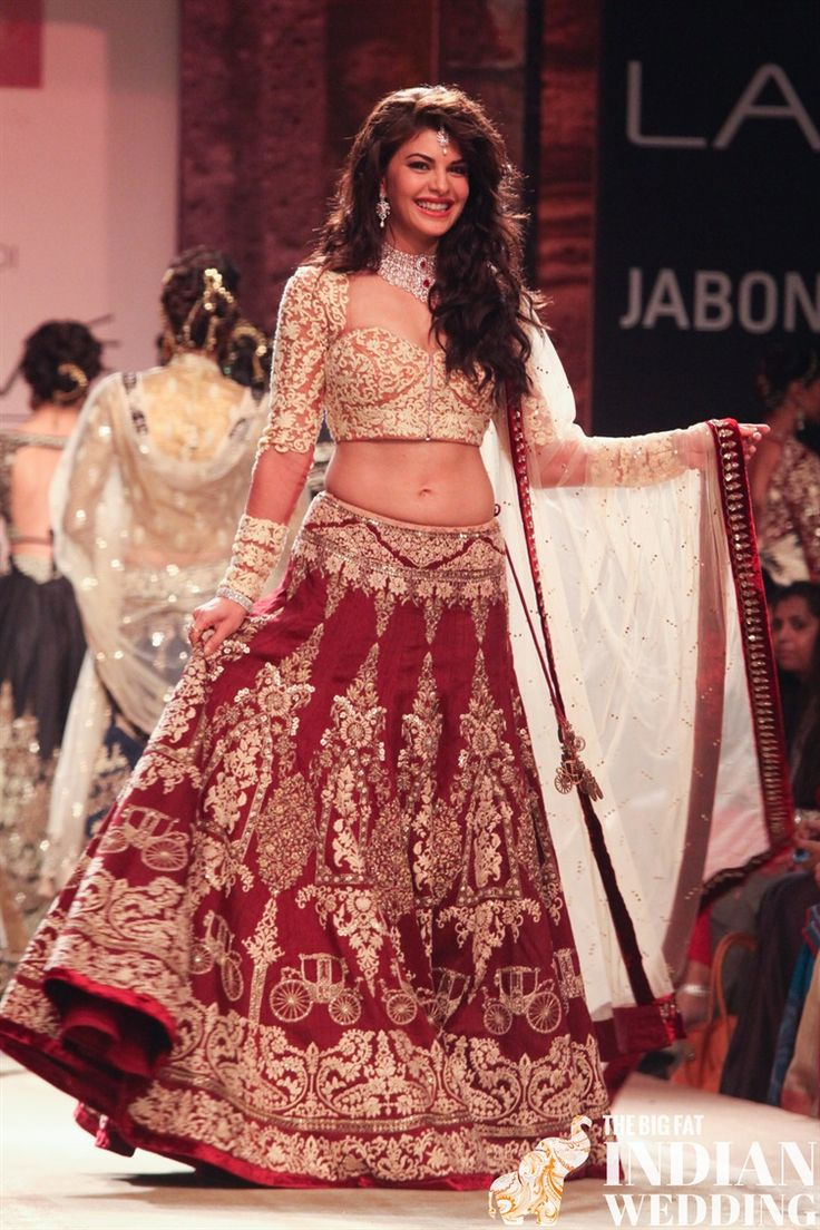 Bollywood star Jacqueline Fernandez in a red and white Indian lengha | Anju Modi Lakme Fashion Week Winter 2014