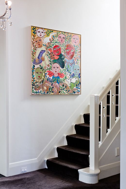 'Family' by Mirka Mora hangs in the entrance hall – a portrait of Natalie's Family | The Melbourne home of Natalie Bloom